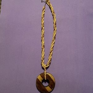 Jewelry - Beaded necklace with Wooden Medallion
